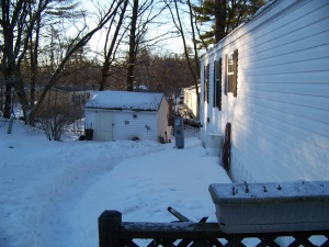 My backyard and shed, notice the path shoveled for the oil delivery man.