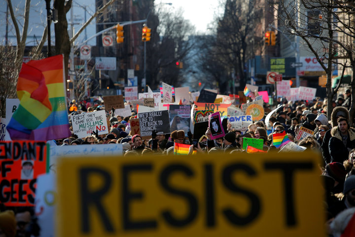 People line Christopher Street during a gathering of the LGBTQ community and supporters protesting U.S. President Donald Trump's agenda in Manhattan
