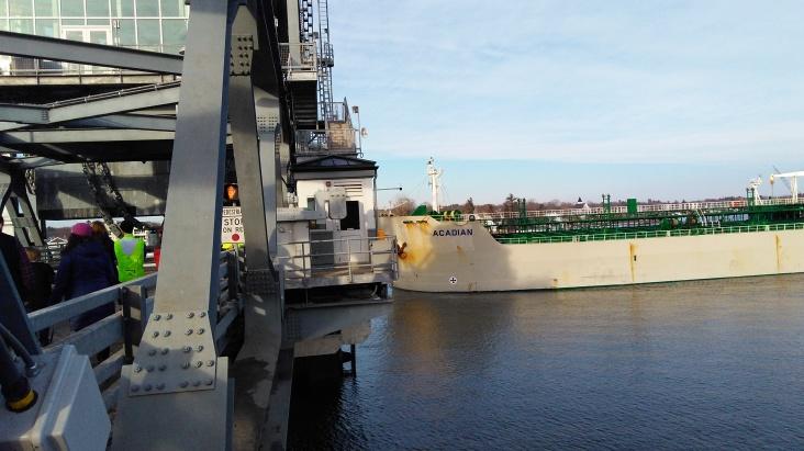 Tanker passing under bridge span